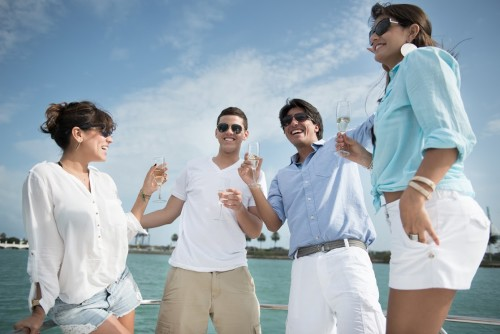 Bigstock- 65814161 - Happy group of friends drinking champagne on a yacht